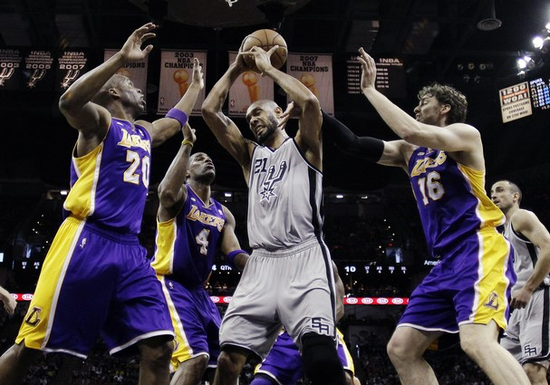 los angeles lakers v san antonio spurs first round series. Tim Duncan in a crowd of lakers.
